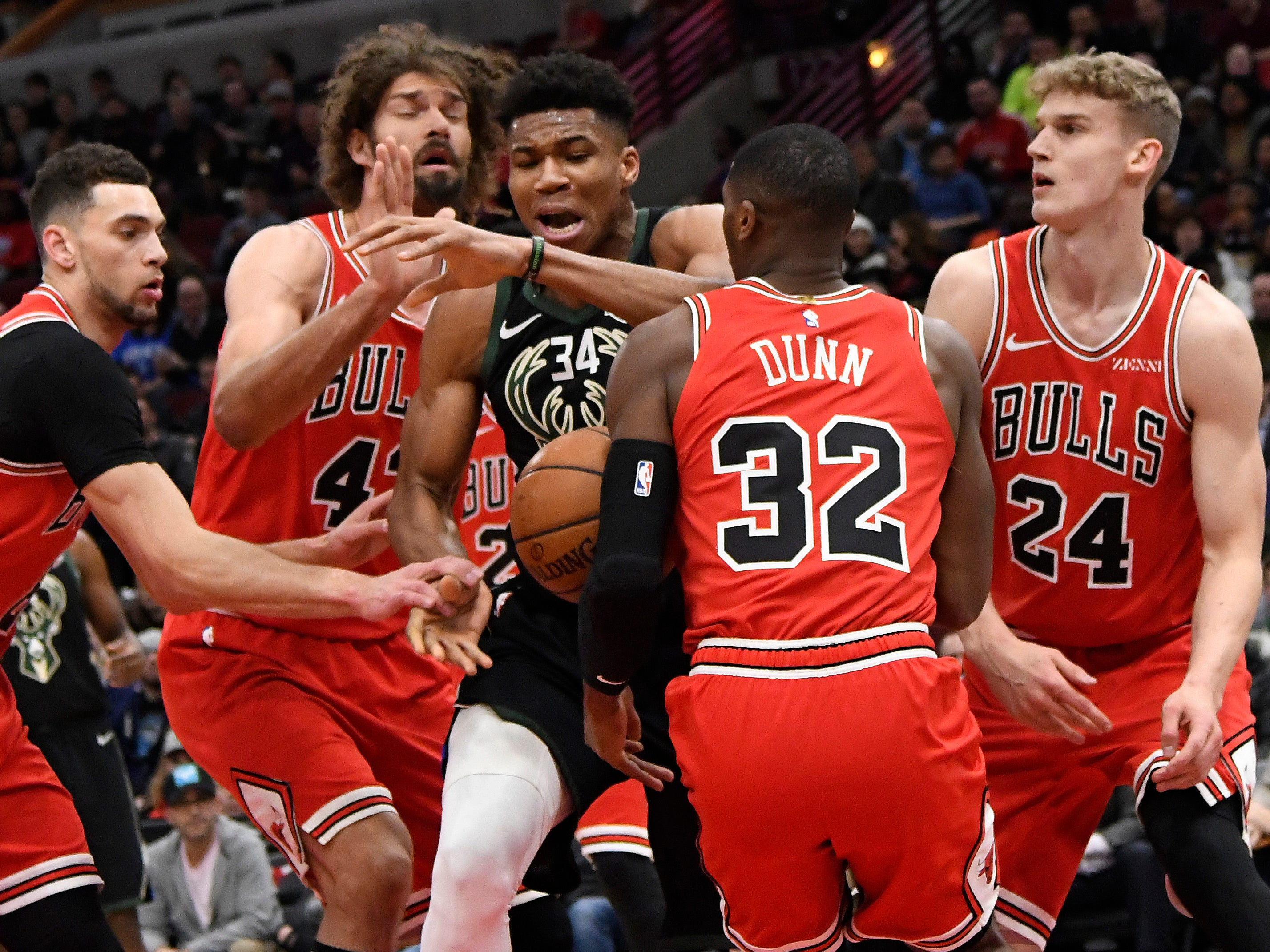 Bucks forward Giannis Antetokounmpo loses the ball as he's surrounded by a quartet of Bulls defenders during teh first half Monday.