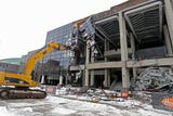Demoltion of the Bradley Center continues as the facade was taken down.