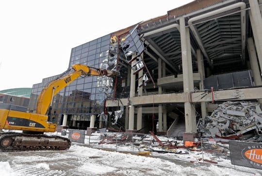 The glass facade on the front of the Bradley Center is shattered Tuesday as demolition continues.