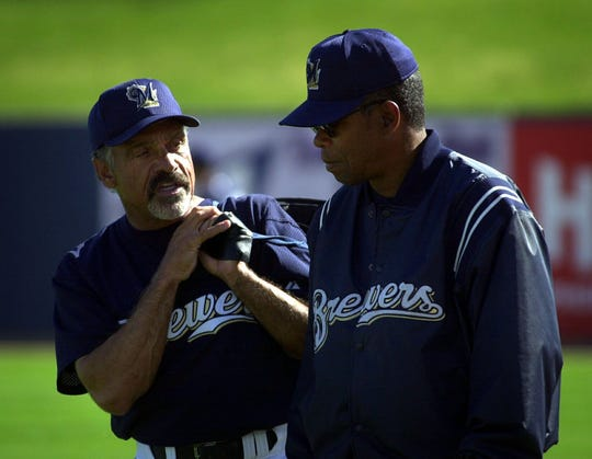 Brewers manager Davey Lopes talks with batting coach Rod Carew before a game during spring training in 2000.