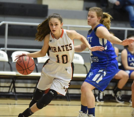 Calico Rock's Jude Lindsey drives to the basket during the Lady Pirates' district victory over Western Grove on Monday.