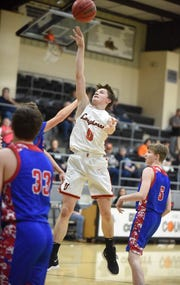 Viola's Blaine Marberry puts up a shot against Bruno-Pyatt on Monday night.
