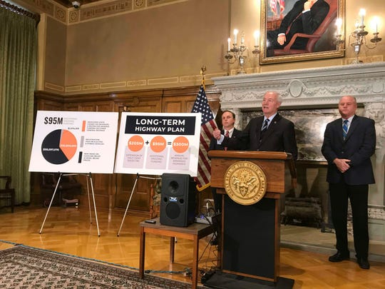 Arkansas Gov. Asa Hutchinson speaks at the state Capitol Monday in Little Rock, Arkansas about his proposed highway funding plan.