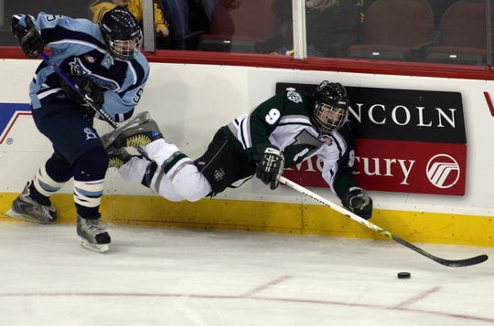Delbarton's Kenny Agostino (right) and St. Augustine's Rob DeSimone battle for the puck during the 2008 NJSIAA Non-Public hockey final.