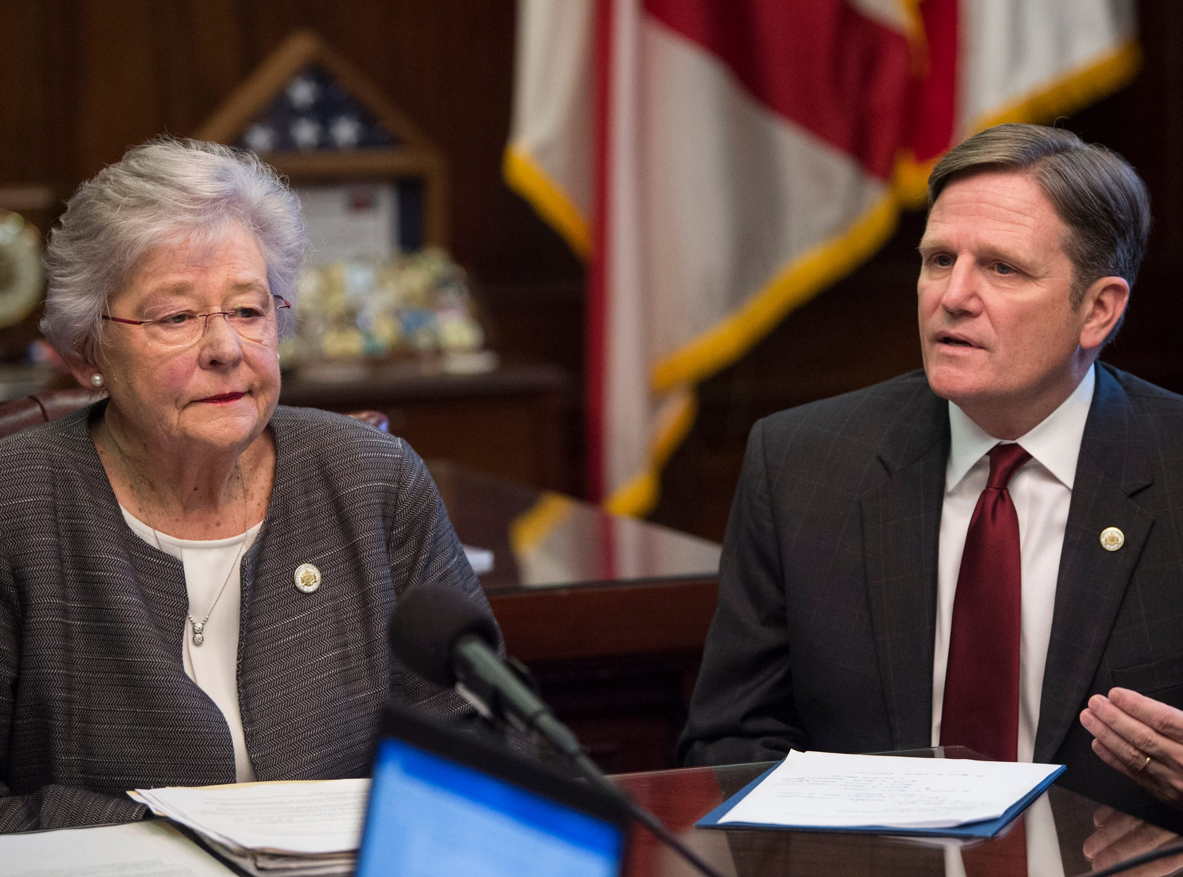 Jeff Dunn, Commissioner of the Alabama Department of Corrections, speaks with Gov. Kay Ivey during a press conference in the Governor's office at the Alabama State Capitol in Montgomery, Ala., on Tuesday, Feb. 12, 2019.