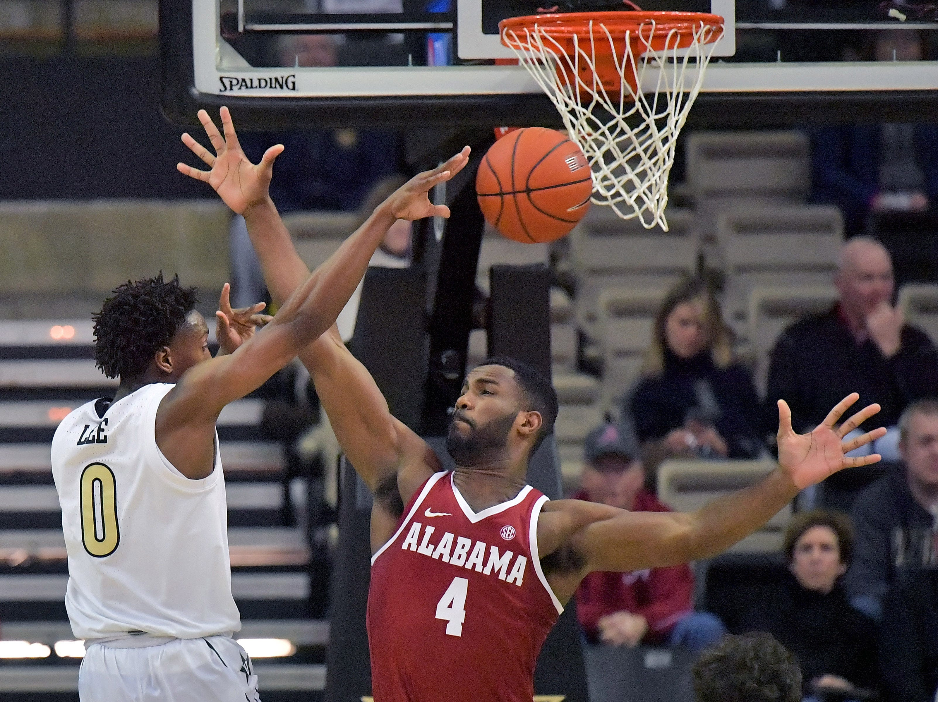 Feb 9, 2019; Nashville, TN, USA; Vanderbilt Commodores guard Saben Lee (0) passes against Alabama Crimson Tide forward Daniel Giddens (4) during the second half at Memorial Gymnasium. Alabama won 77-67. Mandatory Credit: Jim Brown-USA TODAY Sports