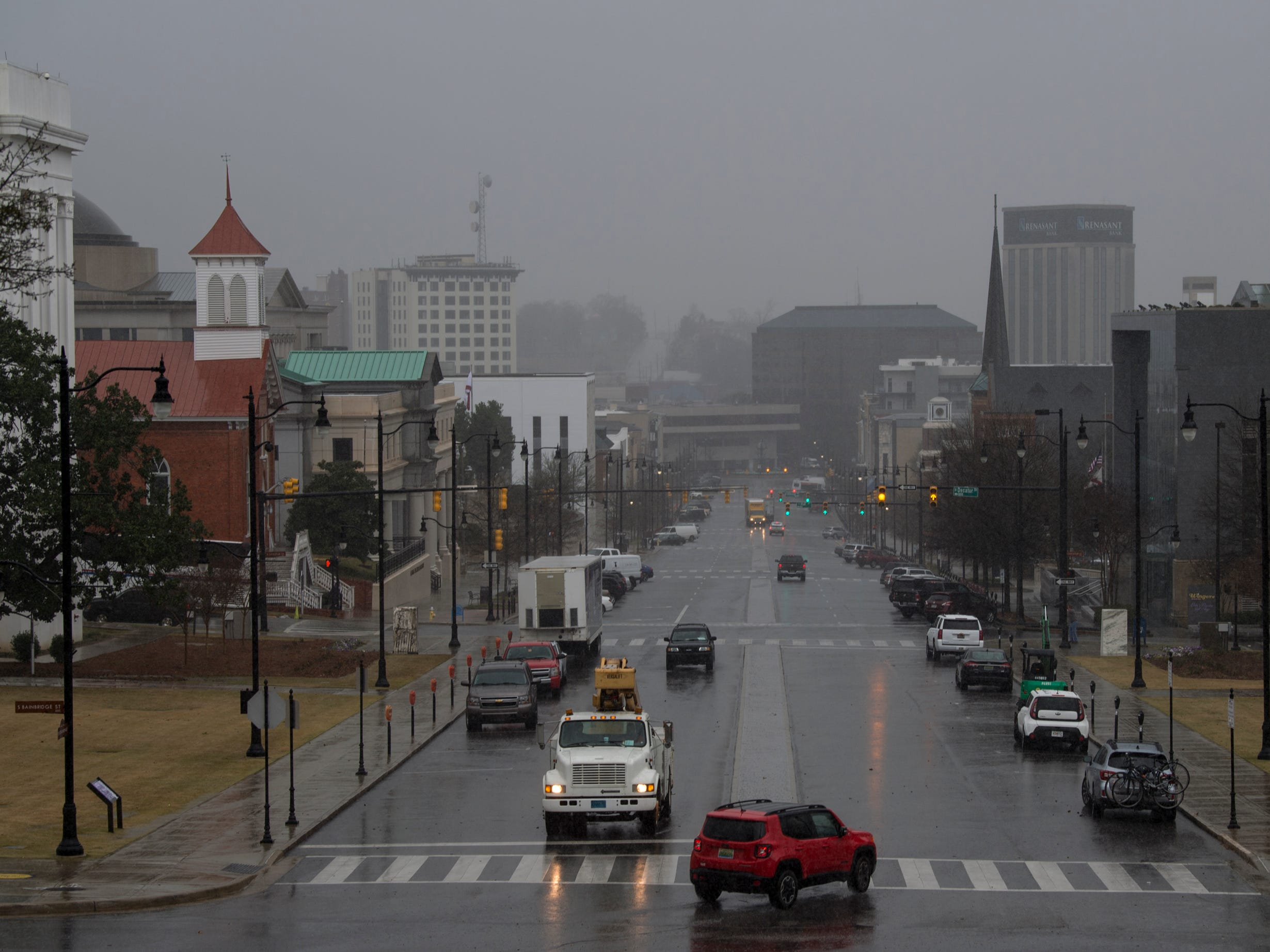 Rainy weather seen down Dexter Ave. in Montgomery, Ala., on Tuesday, Feb. 12, 2019.