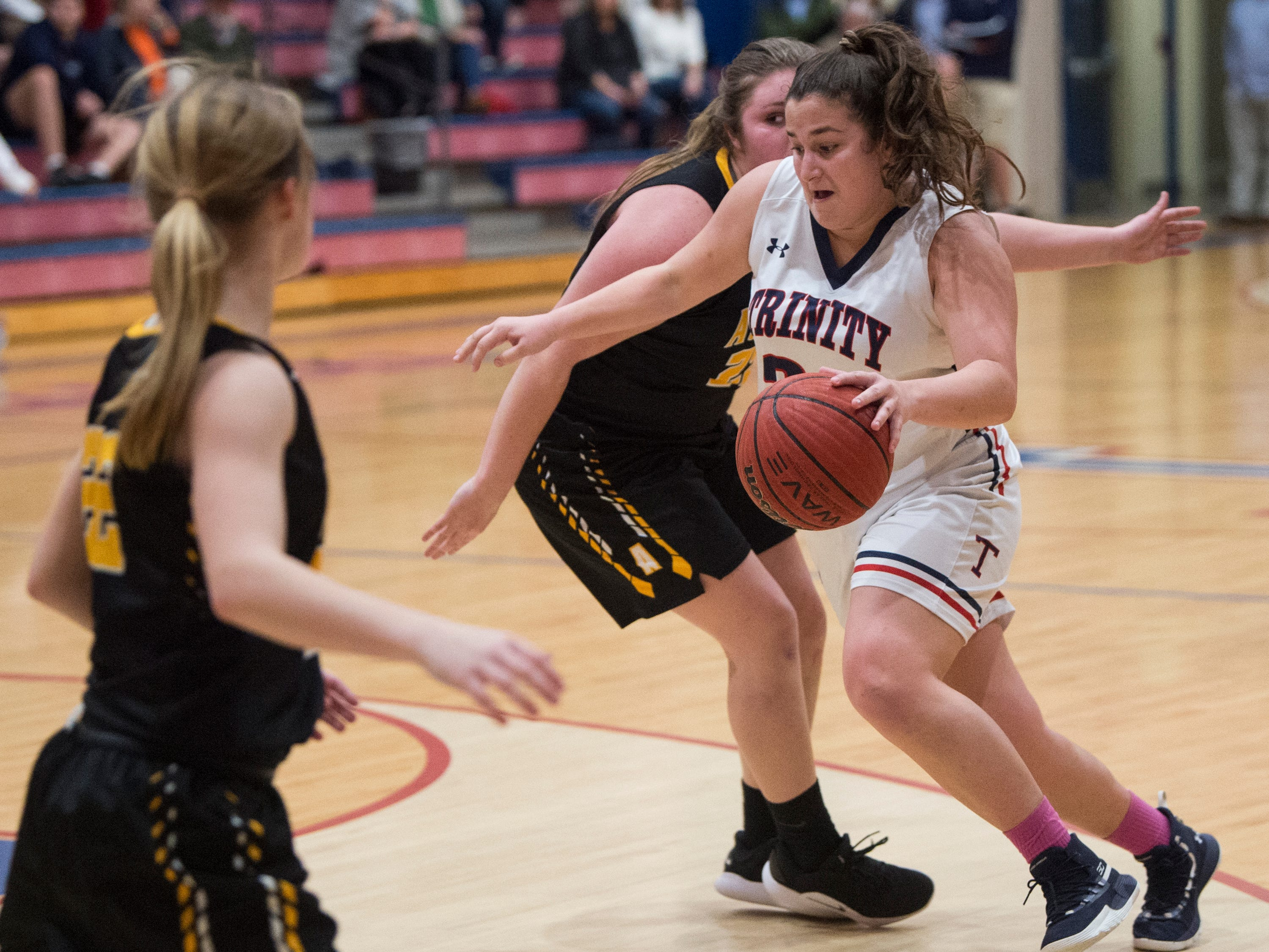 Trinity's Mackenzie Avant (24) drives the ball to the basket during the Class 4A subregional at Trinity Presbyterian High School in Montgomery, Ala., on Monday, Feb. 11, 2019. Trinity defeated Ashford 66-28.