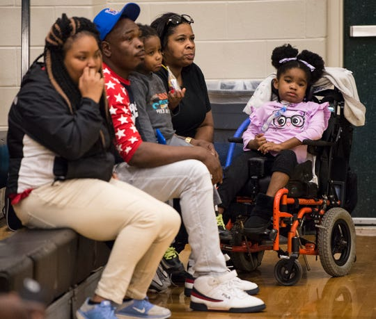 Geonni Johsnon, 4, watches as her brother Lee's Demond Robinson plays basketball against Carver at Carver High School in Montgomery, Ala., on Friday, Jan. 25, 2019.