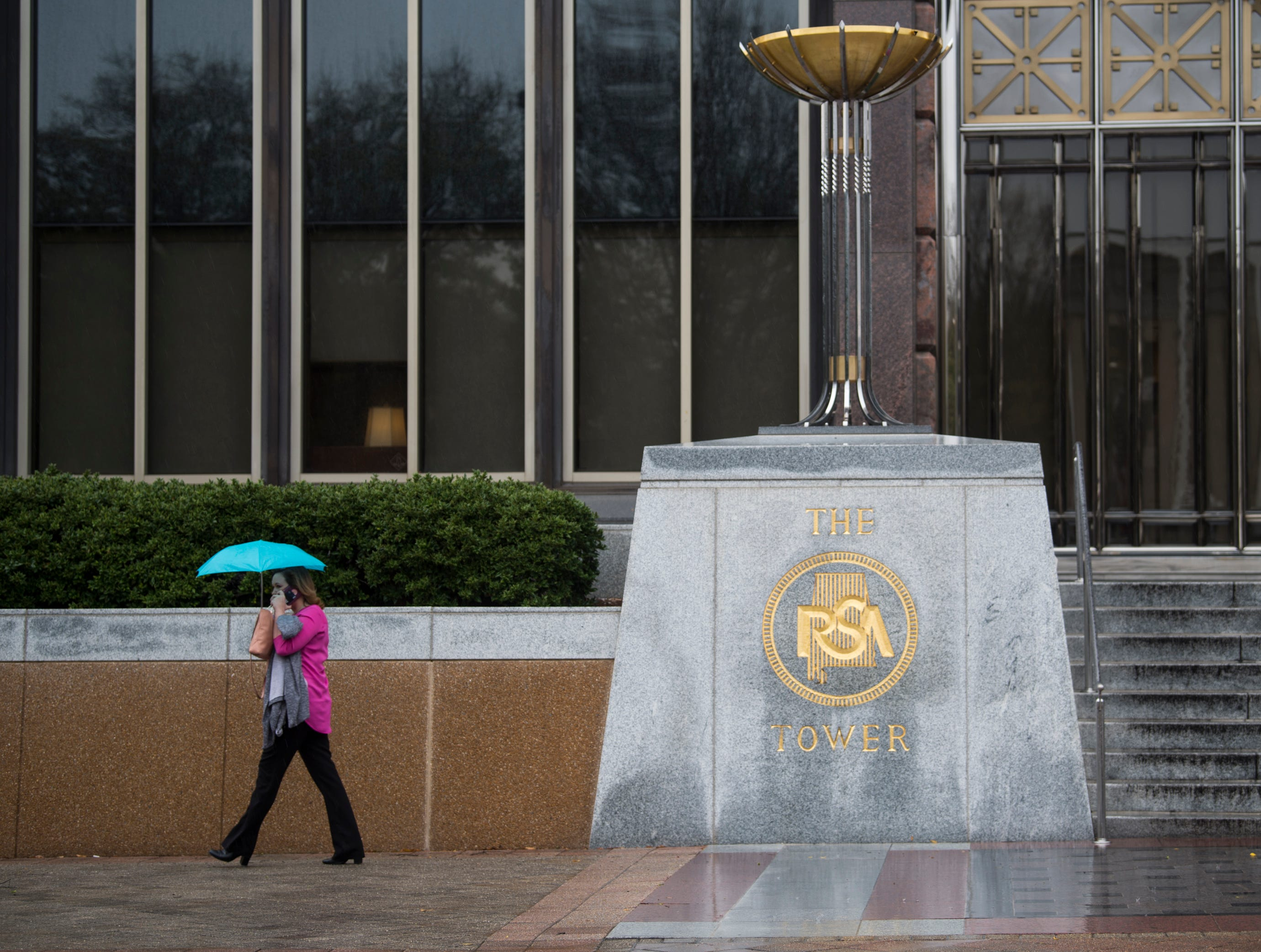 A pedestrian fight the wet weather in Montgomery, Ala., on Tuesday, Feb. 12, 2019.