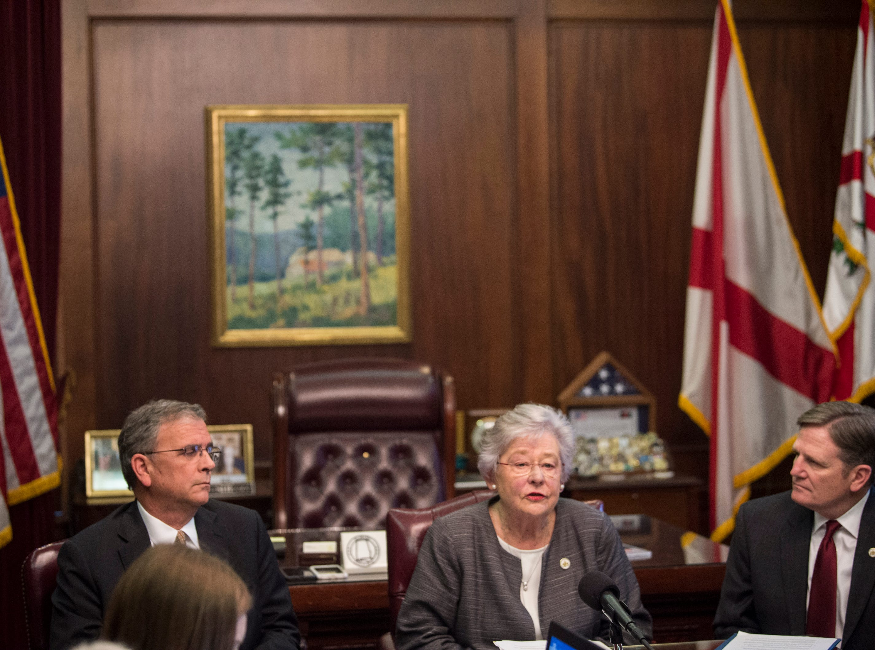 Gov. Kay Ivey, middle speaks with Mike Lanier, left, president of HPM leadership, and Jeff Dunn, right, Commissioner of the Alabama Department of Corrections, during a press conference in the Governor's office at the Alabama State Capitol in Montgomery, Ala., on Tuesday, Feb. 12, 2019.