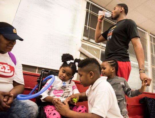 Demond Robinson hangs out with his family from left, Felecia Johnson, mom, Geonni, 4, Jujuan, 8, and Geo, 4, after his game in Montgomery, Ala., on Tuesday, Feb. 5, 2019. Geonni was diagnosed with Acute flaccid myelitis a nervous system disease after she fell ill last year.