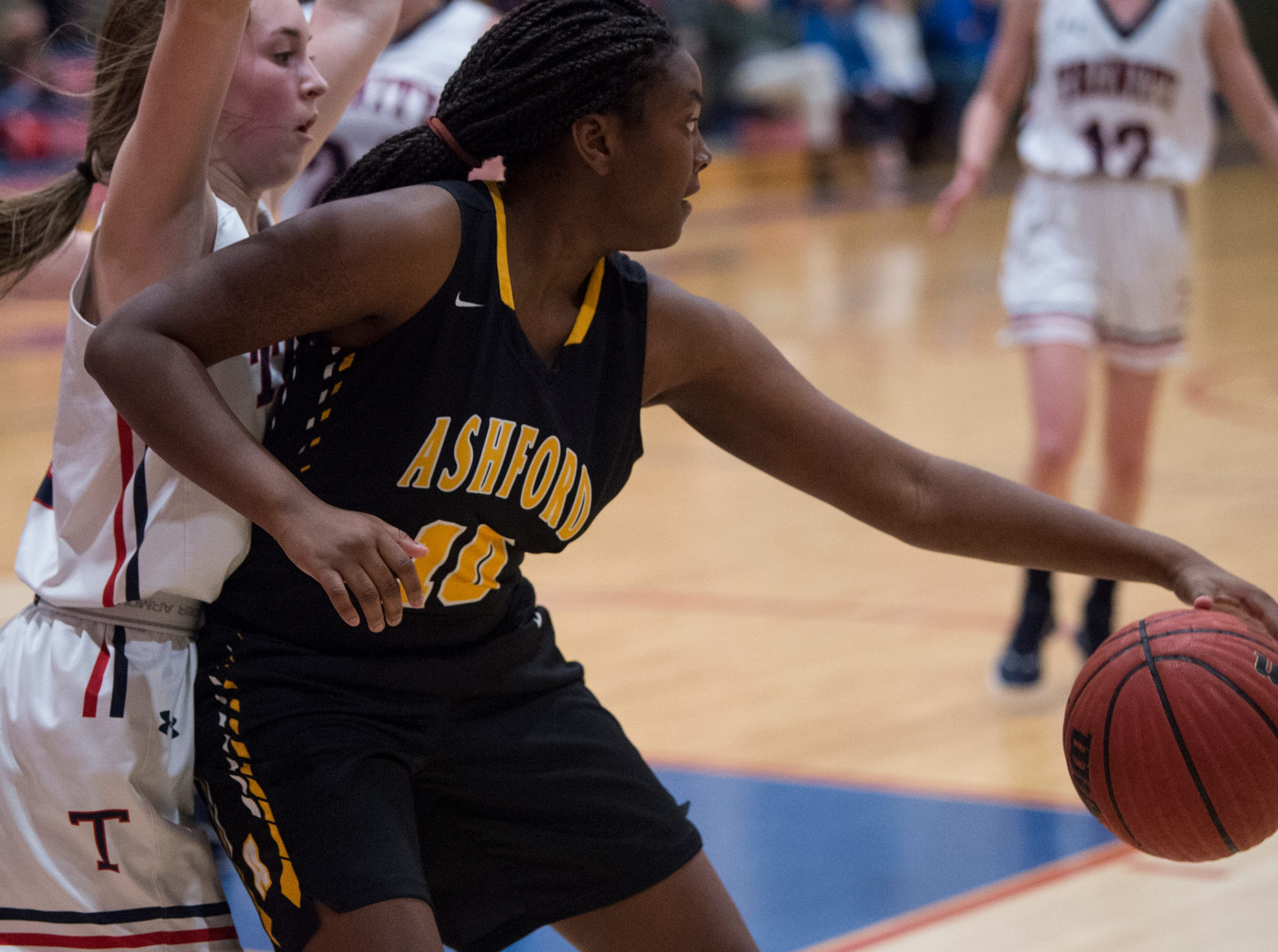 Ashford's Nevaeh Williams (10) dribbles the ball in the post during the Class 4A subregional at Trinity Presbyterian High School in Montgomery, Ala., on Monday, Feb. 11, 2019. Trinity defeated Ashford 66-28.