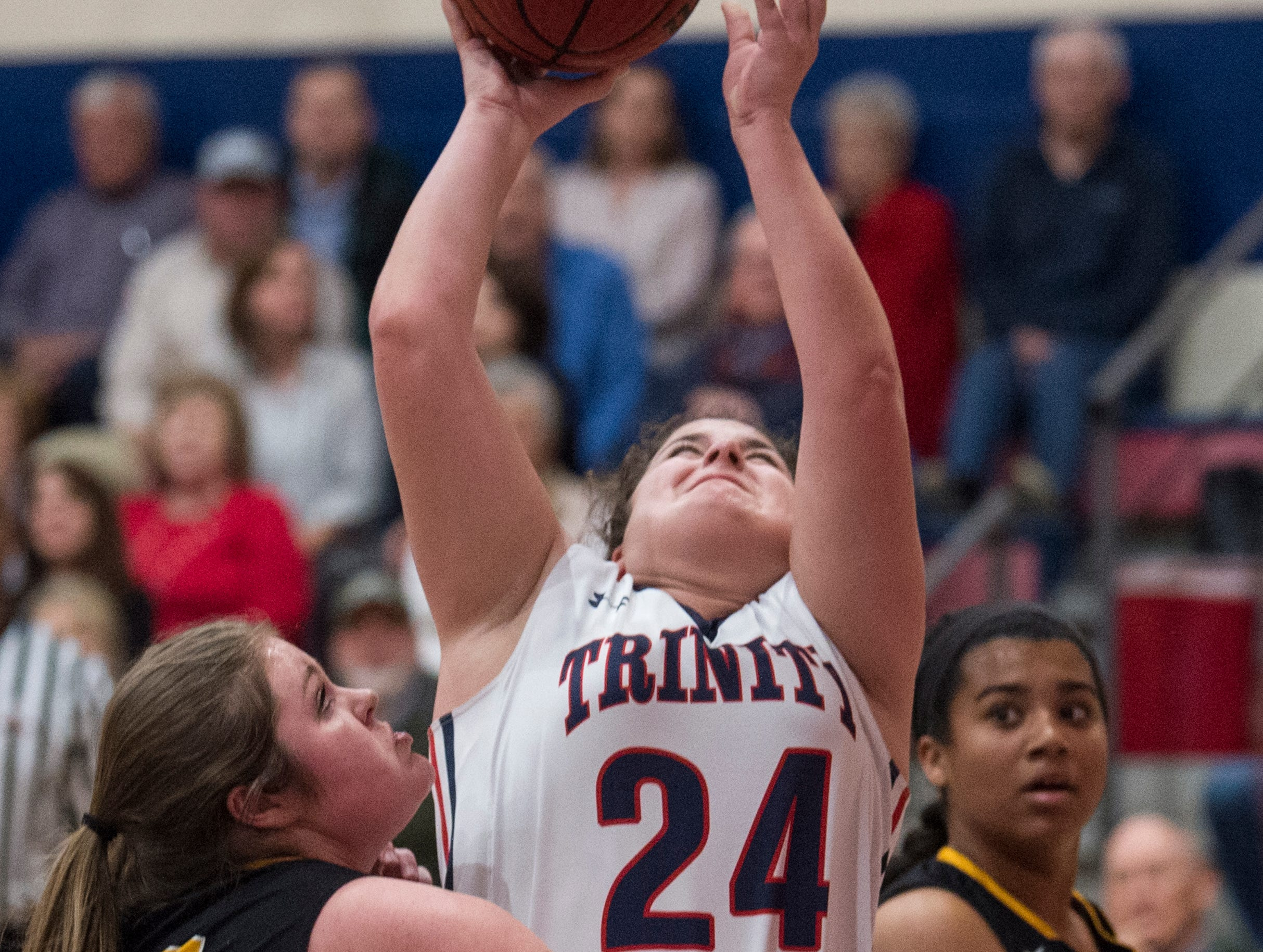 Trinity's Mackenzie Avant (24) goes up for a layup during the Class 4A subregional at Trinity Presbyterian High School in Montgomery, Ala., on Monday, Feb. 11, 2019. Trinity defeated Ashford 66-28.