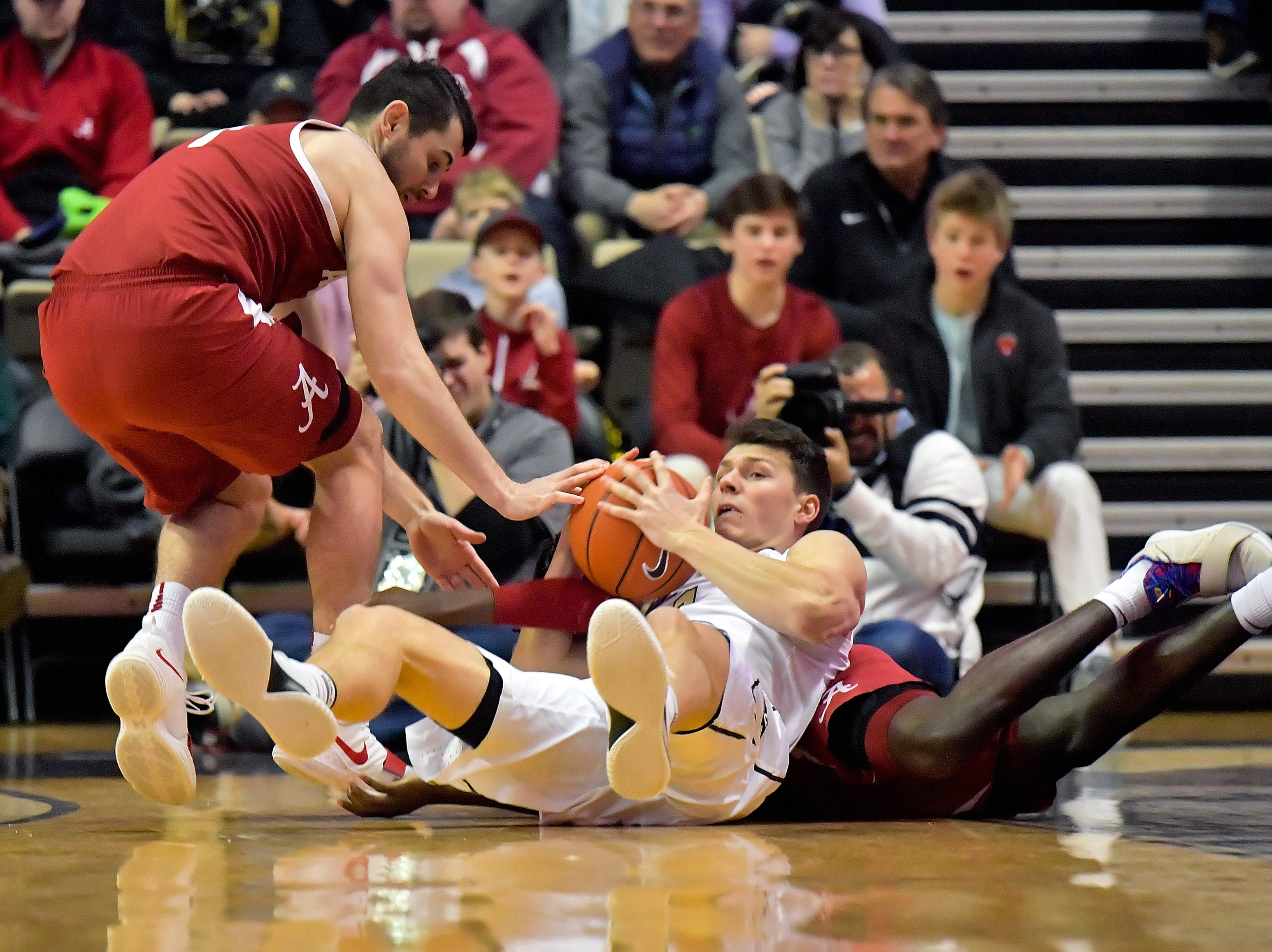 Feb 9, 2019; Nashville, TN, USA; Vanderbilt Commodores forward Yanni Wetzell (1) attempts to control the loose ball against Alabama Crimson Tide guard Riley Norris (1) during the first half at Memorial Gymnasium. Mandatory Credit: Jim Brown-USA TODAY Sports