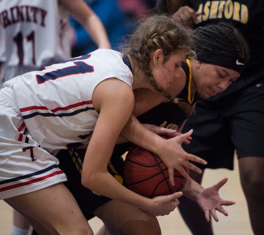 Trinity's Kaylee Peevy (21) and Ashford's Melissa Ford (3) fight for a loose ball during the Class 4A subregional at Trinity Presbyterian High School in Montgomery, Ala., on Monday, Feb. 11, 2019. Trinity defeated Ashford 66-28.