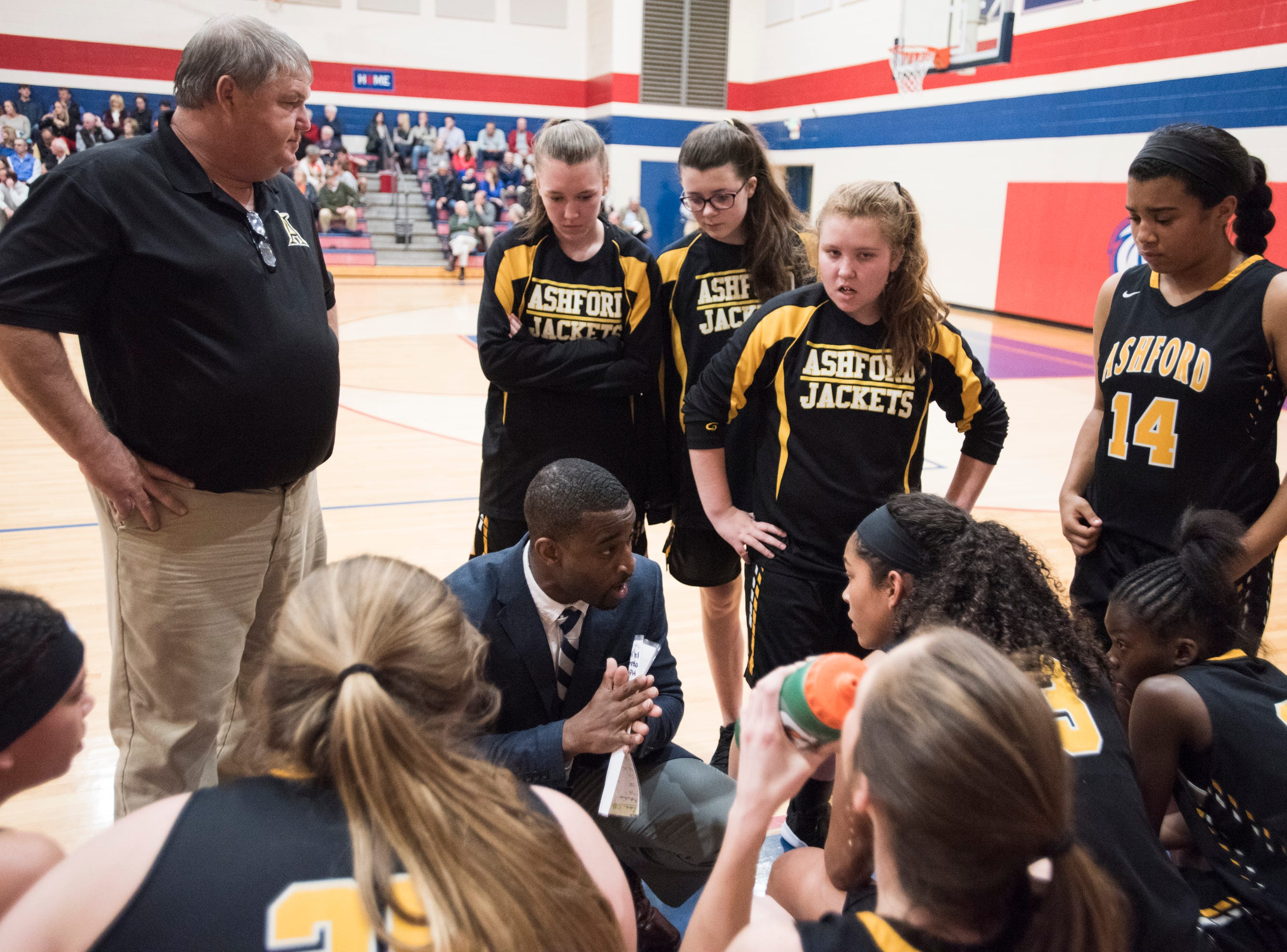 Ashford head coach Terrance Thomas talks with his team during a timeout during the Class 4A subregional at Trinity Presbyterian High School in Montgomery, Ala., on Monday, Feb. 11, 2019. Trinity defeated Ashford 66-28.
