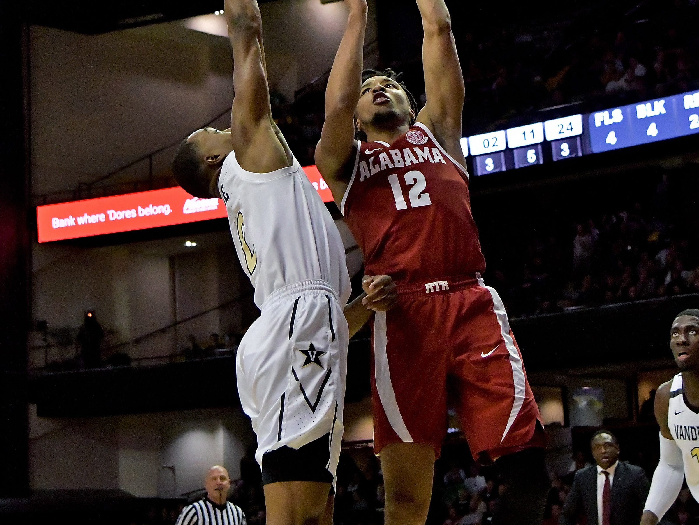 Feb 9, 2019; Nashville, TN, USA; Alabama Crimson Tide guard Dazon Ingram (12) shoots against Vanderbilt Commodores guard Joe Toye (2) during the second half at Memorial Gymnasium. Alabama won 77-67. Mandatory Credit: Jim Brown-USA TODAY Sports