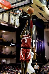 Feb 9, 2019; Nashville, TN, USA; Alabama Crimson Tide guard Kira Lewis Jr. (2) shoots against Vanderbilt Commodores guard Saben Lee (0) during the first half at Memorial Gymnasium. Mandatory Credit: Jim Brown-USA TODAY Sports