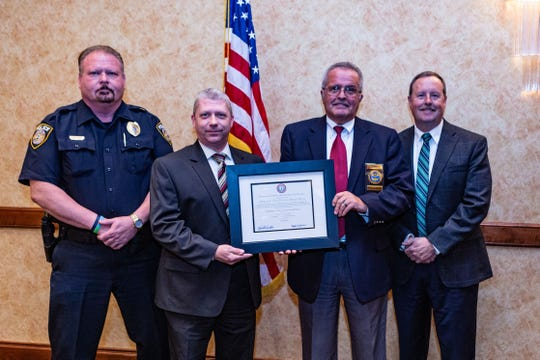 (L-R) Deputy Chief Kenny Ray, Detective Jason Matlock, Chief Marc Coulon and Tennessee Association Chiefs of Police President Randy Evans.