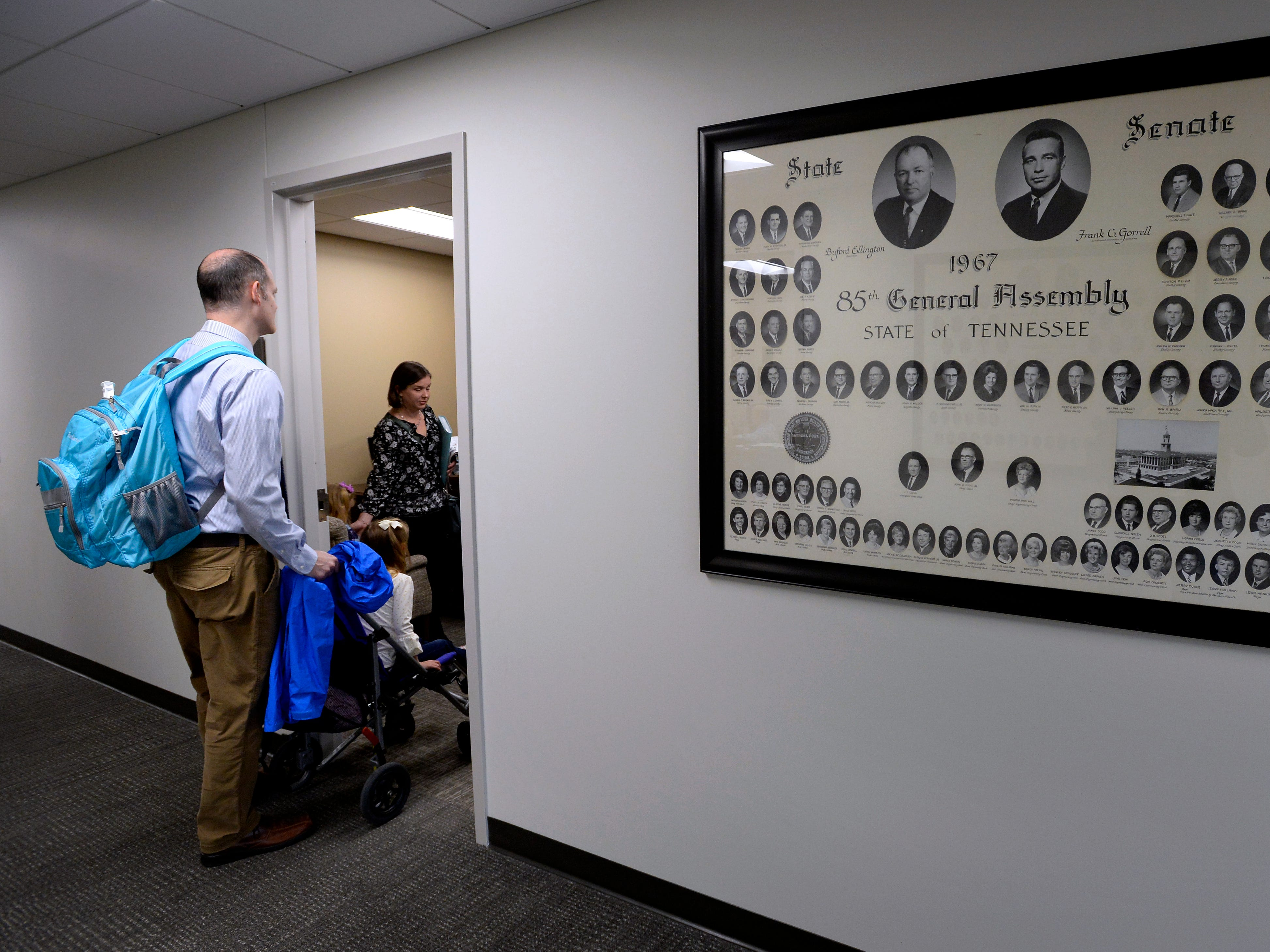 Sean, Claire, 4, and Jessica Fox enter the office of Tennessee State Senator Becky Duncan Massy, R-Knoxville, before talking with her during Disability Day on the Hill Tuesday, Feb. 12, 2019, in Nashville, Tenn. Families and advocates of people with disabilities in Tennessee met with lawmakers to express concerns and the needs of the disabled in the state.