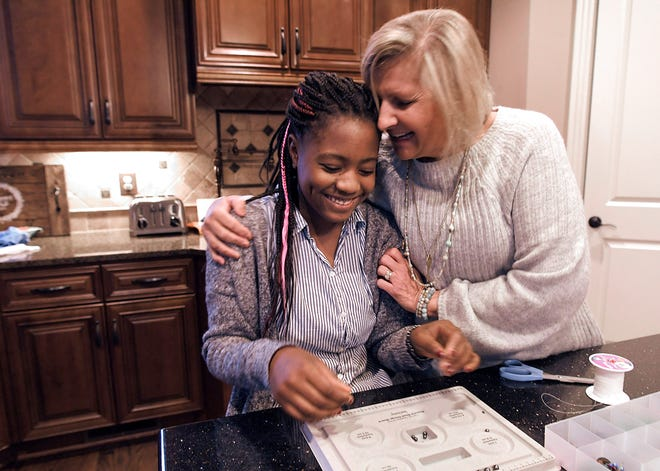 Barb Jones and her daughter, Dara, 12, make jewelry in their Franklin home on Monday, Feb. 11, 2019, for Jones' business. Dara arrived in the United States three weeks after the Haiti earthquake in 2010.