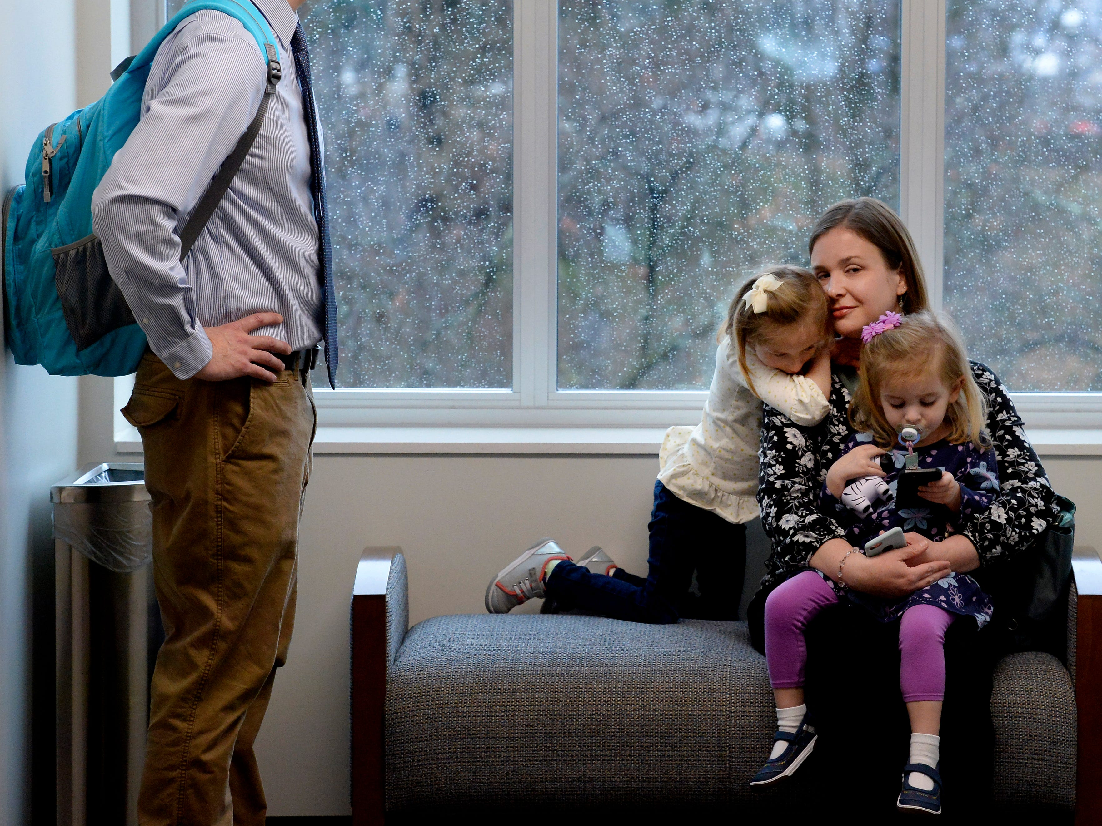Jessica Fox sits in the Cordell Hull building hallway with her daughters Claire, 4, who has cri du chat syndrome, Charli, 2, right, and her husband Sean, left, as they wait to meet Tennessee State Senator Becky Duncan Massy, R-Knoxville, during Disability Day on the Hill Tuesday, Feb. 12, 2019, in Nashville, Tenn. Families and advocates of people with disabilities in Tennessee met with lawmakers to express concerns and the needs of the disabled in the state.