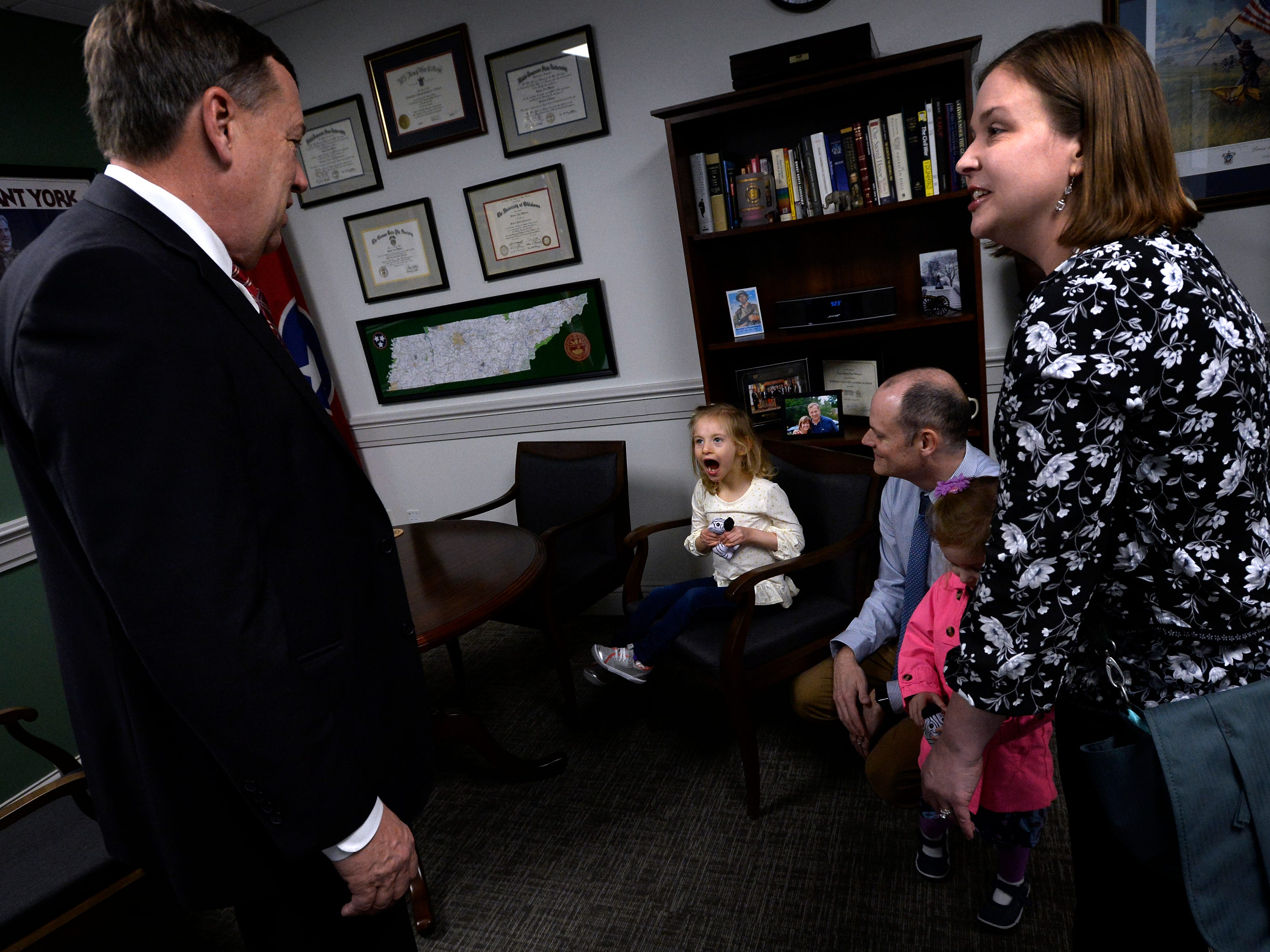 Claire Fox, 4, who has cri du chat syndrome, center, her father Sean and mother Jessica, right, meet with State Rep. Sam Whitson, R-Franklin, left, during Disability Day on the Hill Tuesday, Feb. 12, 2019, in Nashville, Tenn. Families and advocates of people with disabilities in Tennessee met with lawmakers to express concerns and the needs of the disabled in the state.