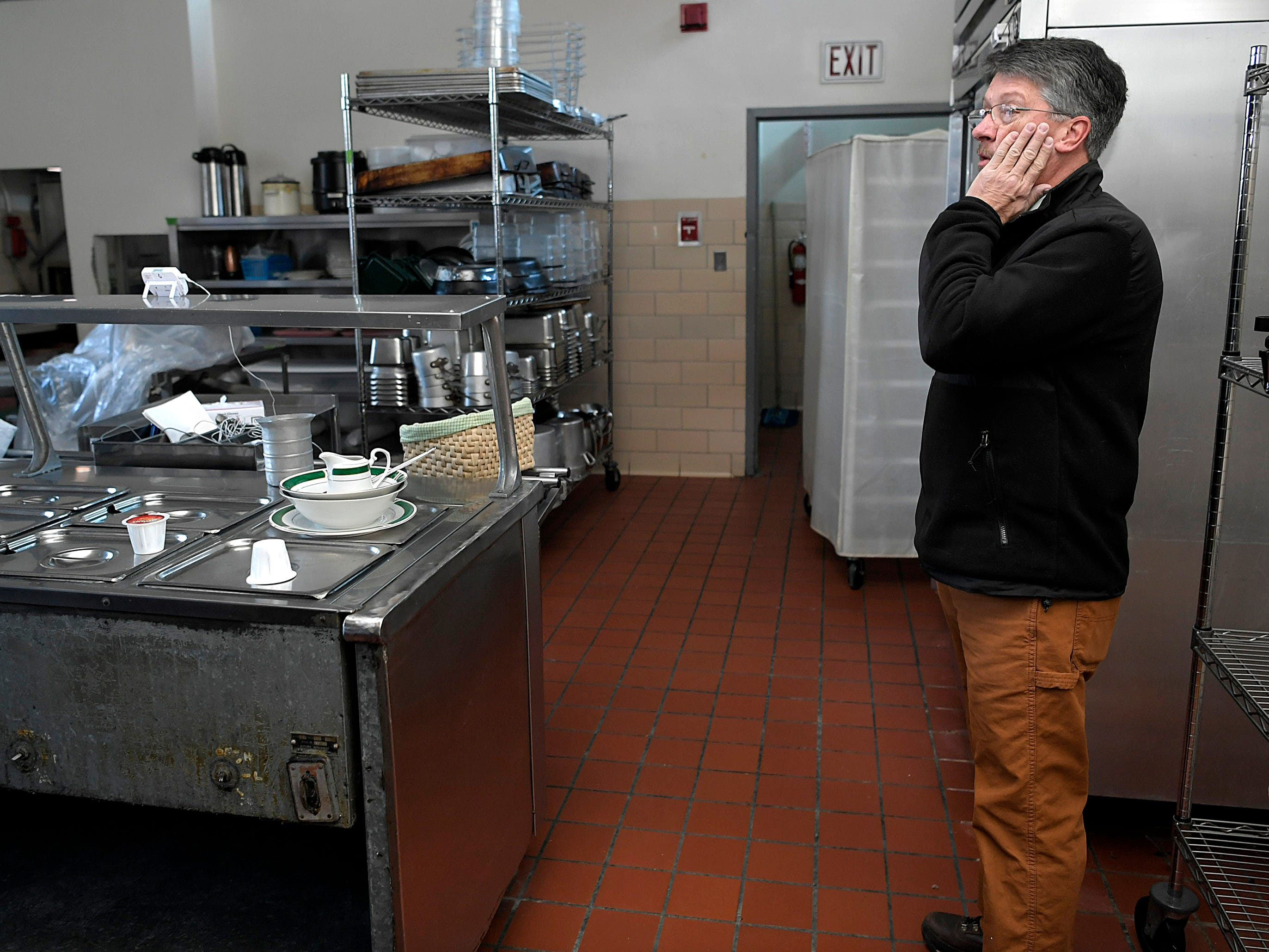 Mayor of Ducktown Mayor Doug Collins surveys the kitchen of Copper Basin Medical Center during a tour inside town's shuttered hospital in Ducktown, Tennessee on Dec. 5, 2018. Copper Basin Medical Center closed 15 months ago due to mounting debt.
