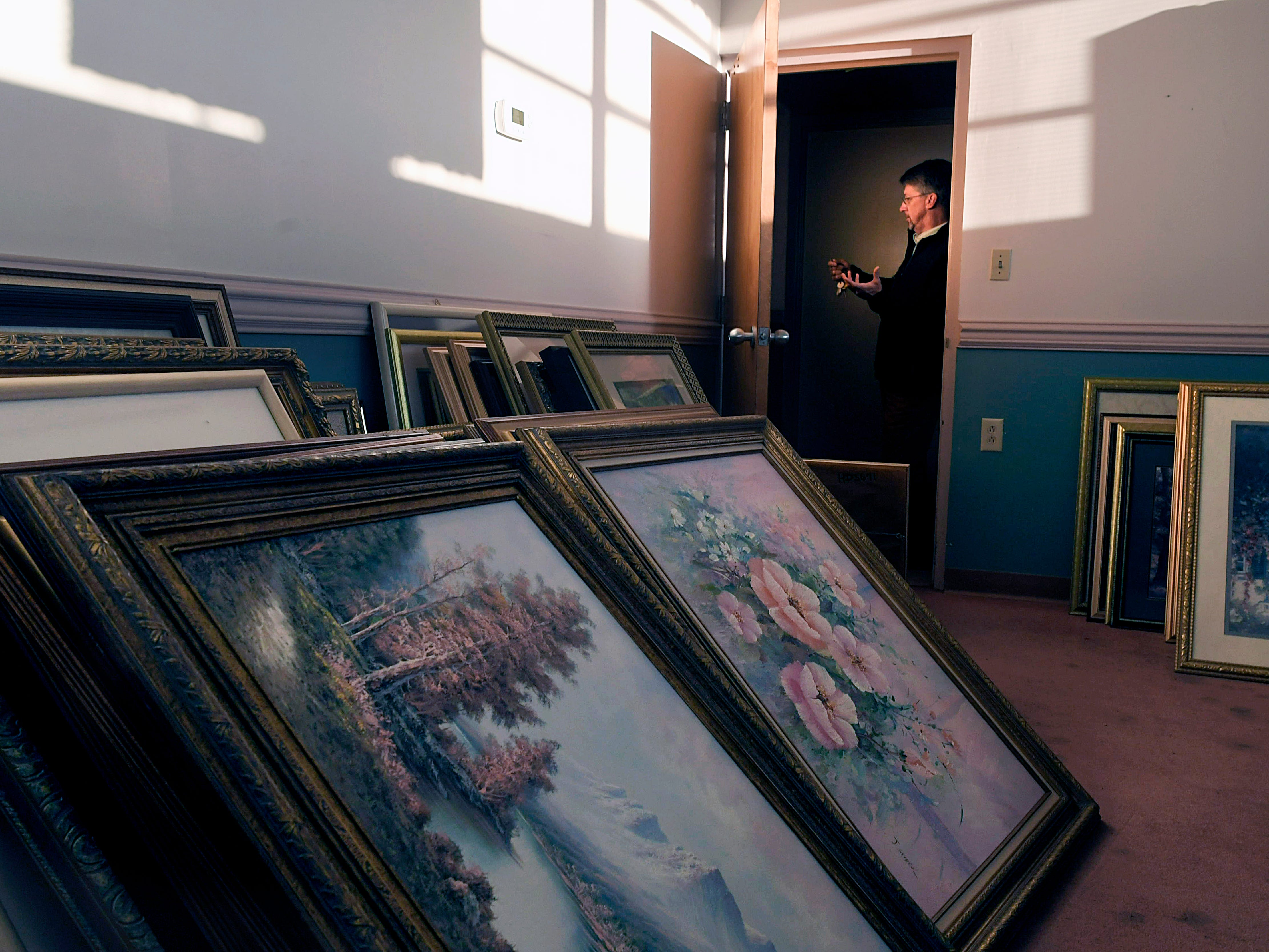 Mayor of Ducktown Mayor Doug Collins stands in a conference room filled with framed artwork inside the town's shuttered hospital, Copper Basin Medical Center in Ducktown, Tennessee on Dec. 5, 2018. Copper Basin Medical Center closed 15 months ago due to mounting debt.