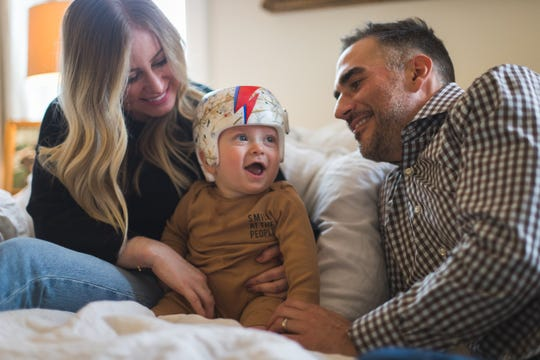 Jilian, Arden and Justin Wright are all smiles after Arden received his newly-painted shaping helmet, created with the assistance of the East Nashville Facebook page and artist Jessica Fife.