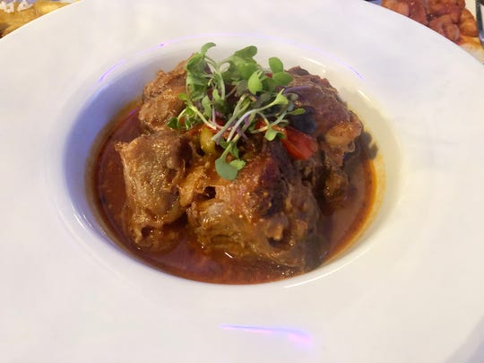 Rabo encendido is a heavenly dish of oxtail stew in a wine reduction tomato sauce at Havana Blue.