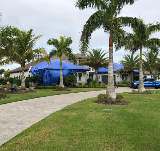 Photo of Turco residence covered in tarp. The tarp was installed on Feb. 11, 2019, to prevent more damage.