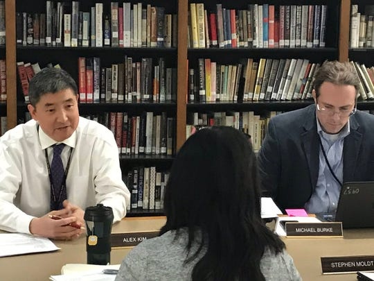 The Cresskill schools superintendent Michael Burke (right) announces during the February 11 meeting that the district's business administrator Alex Kim (left) is resigning from his post. Burke thanked Kim for his work in the district.