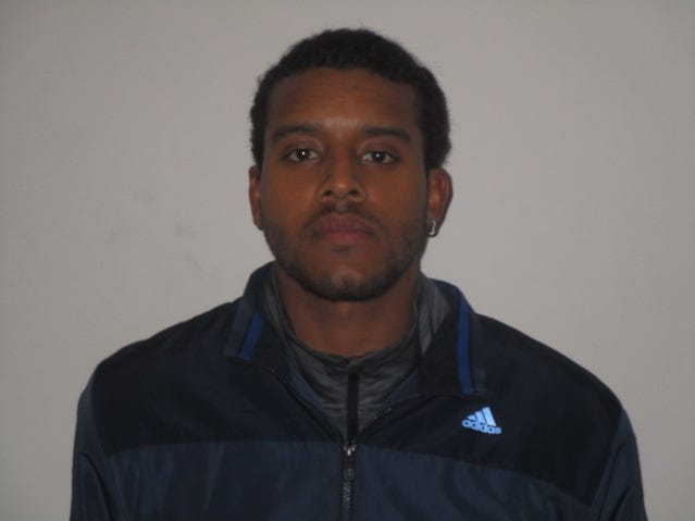 arrested and charged with conspiracy to commit forgery and theft by deception for using counterfeit $100 bills.