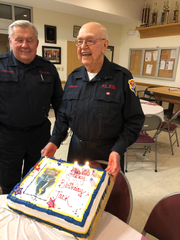 Frankliin Lakes Fire Department President and former mayor Tom Donch looks on as Jack Willer shows off his 98th birthday cake at the Franklin Lakes Firehouse Monday.