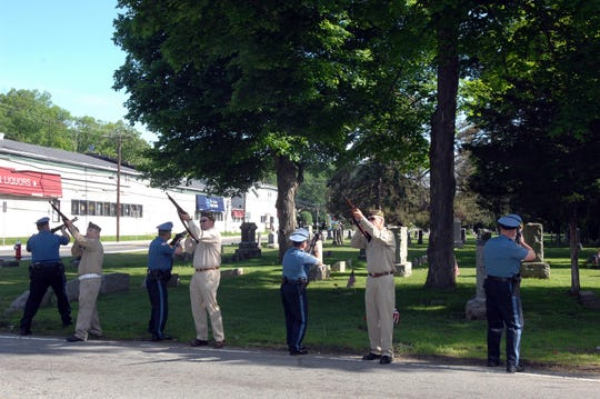 A 21 gun salute before Wanaque's Memorial Day parade is captured in 2014 at Midvale Cemetary.