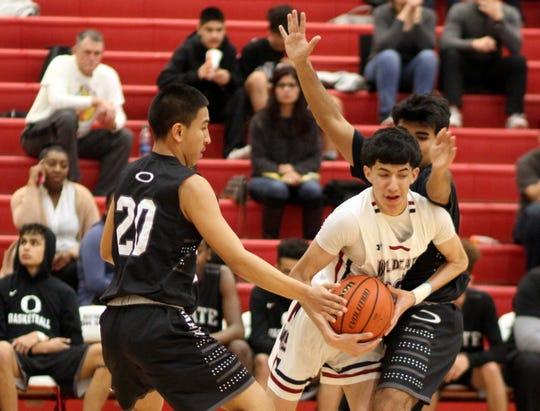 Junior Wildcat Robert Ornelas works his way out of a trap sprung by the Onate Knights' defense. Ornelas and the 'Cats suffered a 58-36 home loss Friday in District 3-5A play.