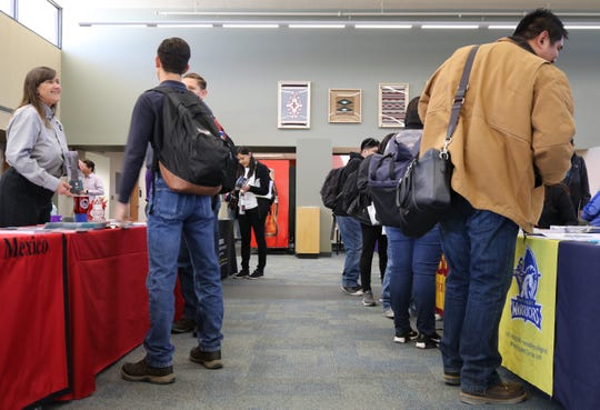 More than 100 students attended the San Juan College Transfer Fair on Tuesday at the college's Student Sun Lounge in Farmington.