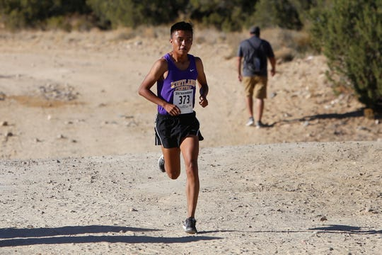 Kirtland Central's Kashon Harrison, seen here at the Totah Invitational on Sept. 21, 2018 in Farmington, was named the 2018 New Mexico Player of the Year in cross country.