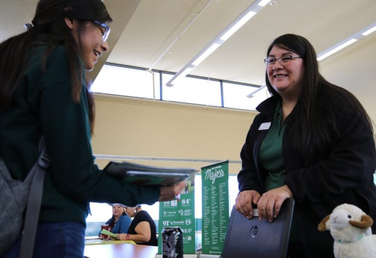 Colorado State University admissions counselor Aliyah Cardona, right, talks to student McKayla Tsabetsaye about the university's psychology program during the San Juan College Transfer Fair on Tuesday.