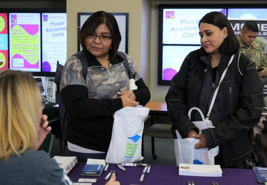 San Juan College students met with representatives from more than 10 colleges and universities during a transfer fair on Tuesday in the college's Student Sun Lounge in Farmington.