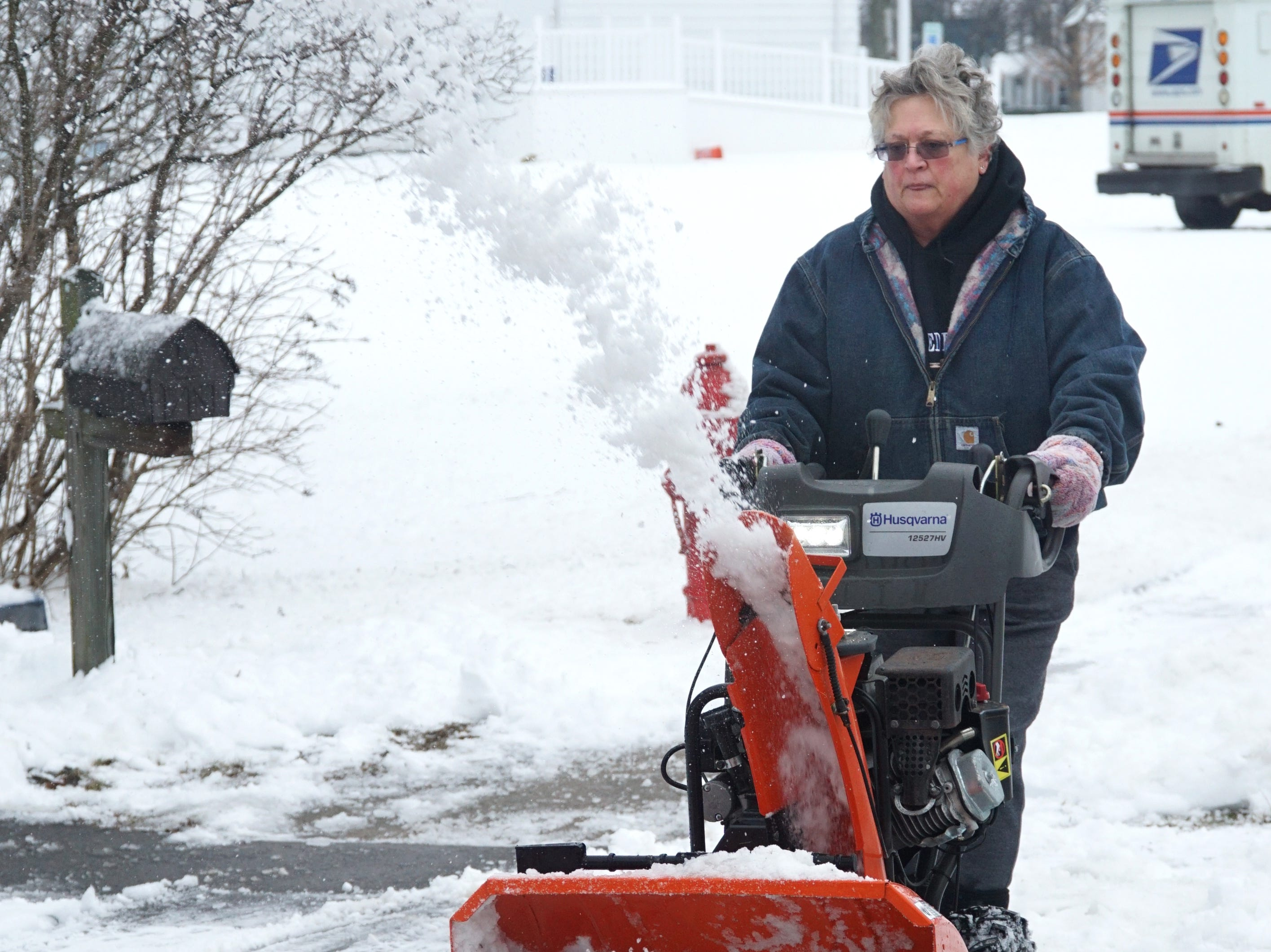 Walled Lake's Mayor Linda Ackley clears snow from her driveway near the Oakland County town's north end on Feb. 12. Ackley has been mayor since 2013 and needed some time that day to clear a lot of snow and ice from in front of her home.