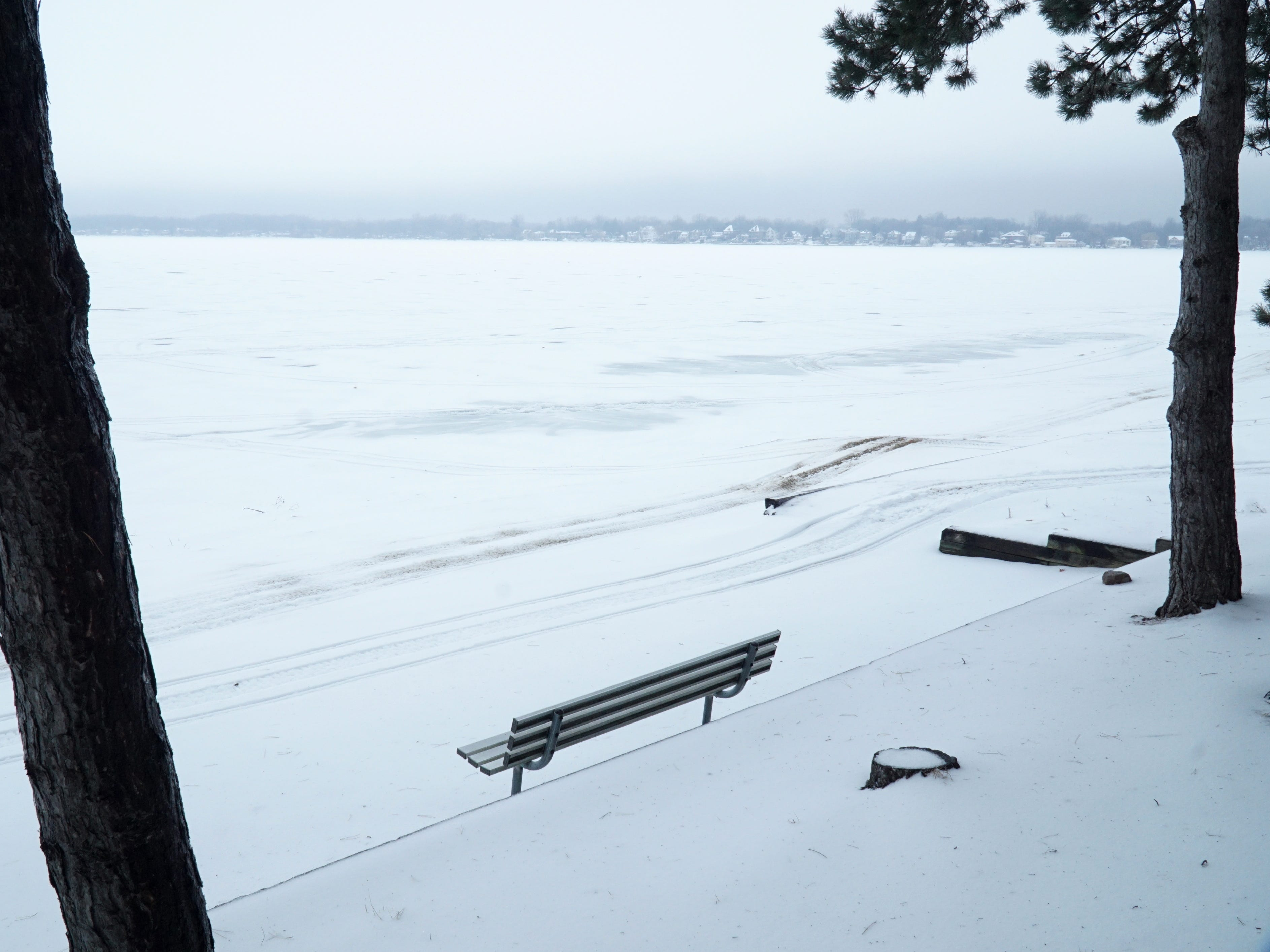 The south end of Walled Lake beckons to anyone who wants to hang out on its huge ice-covered surface on Feb. 12. There weren't many people on the lake that day, just a few ice fishermen on its north side.