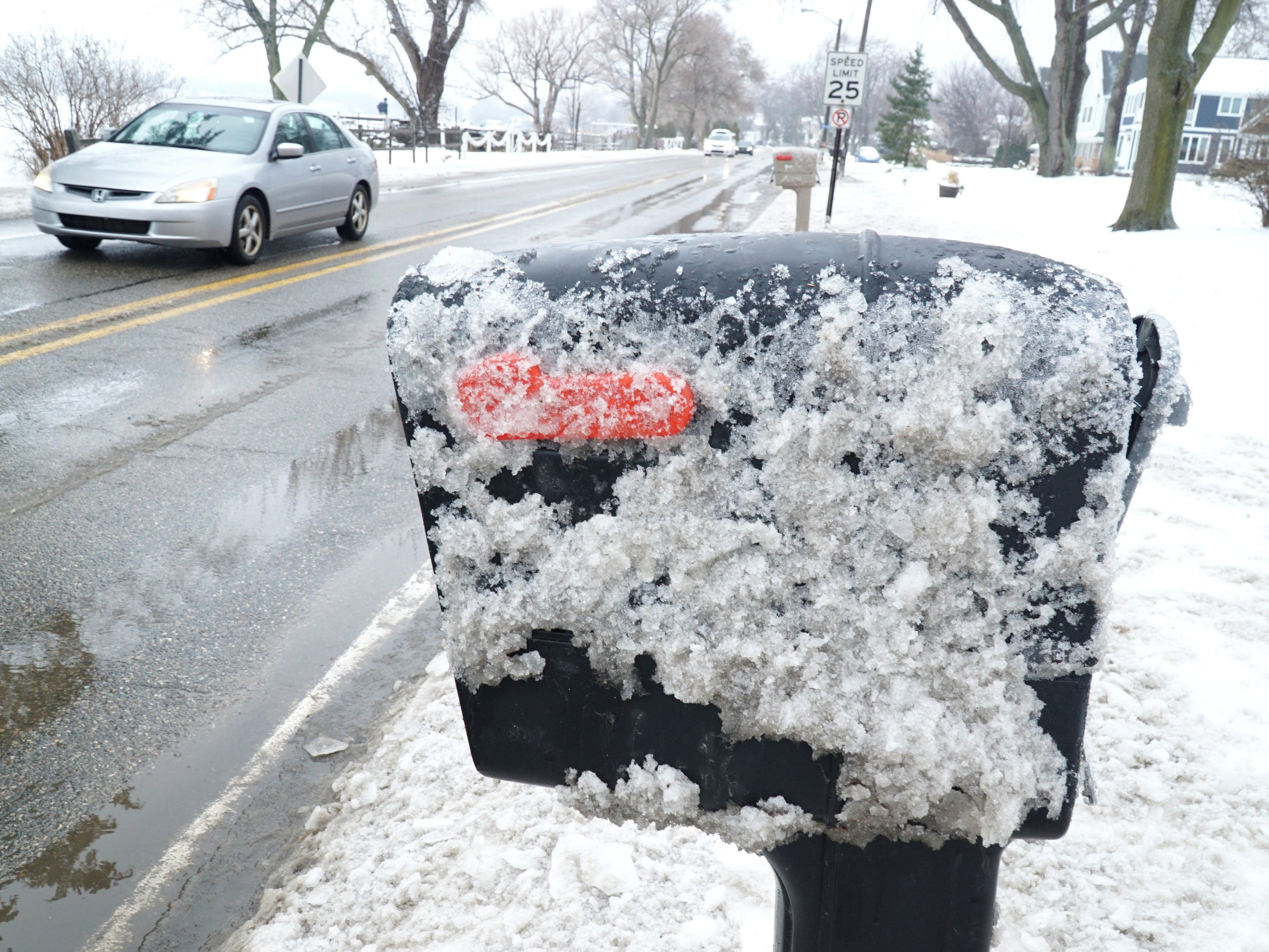 Plows have pushed up a lot of mess on area mailboxes along the side of roads - including these in southwestern Oakland County.