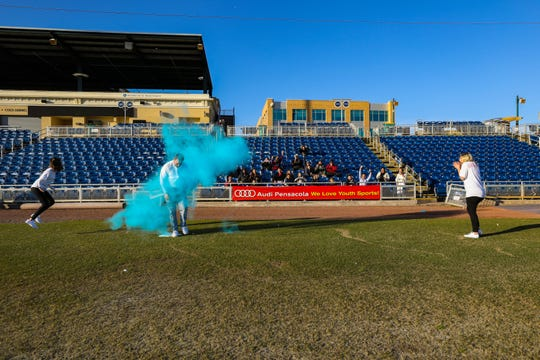 Dalton and Sarissa Ghigliotty learn their new child's gender during a gender reveal party in early January at Blue Wahoos Stadium in downtown Pensacola.