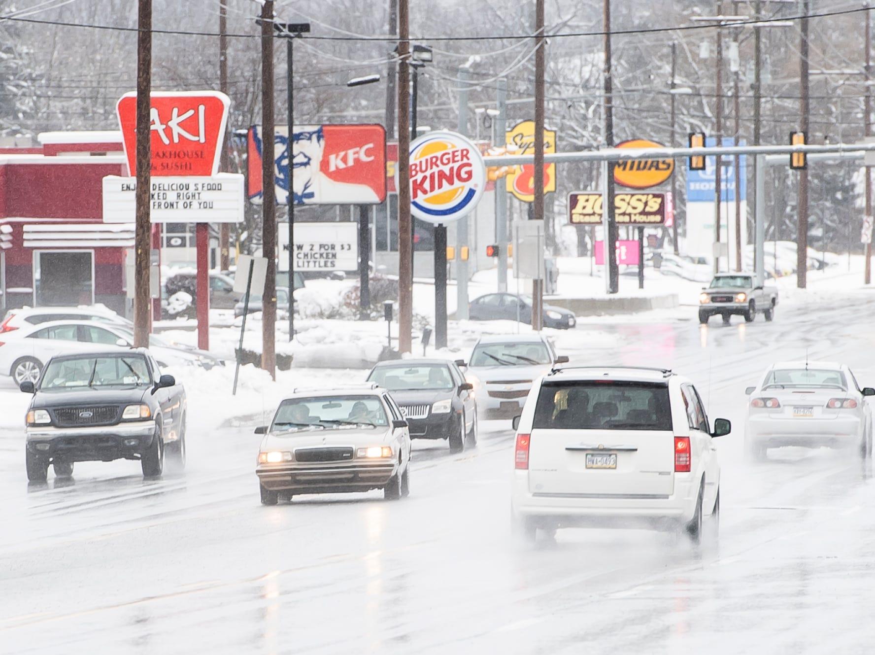 Motorists drive through a wintry mix of freezing rain on Carlisle Street in Hanover Borough Tuesday, February 12, 2019.
