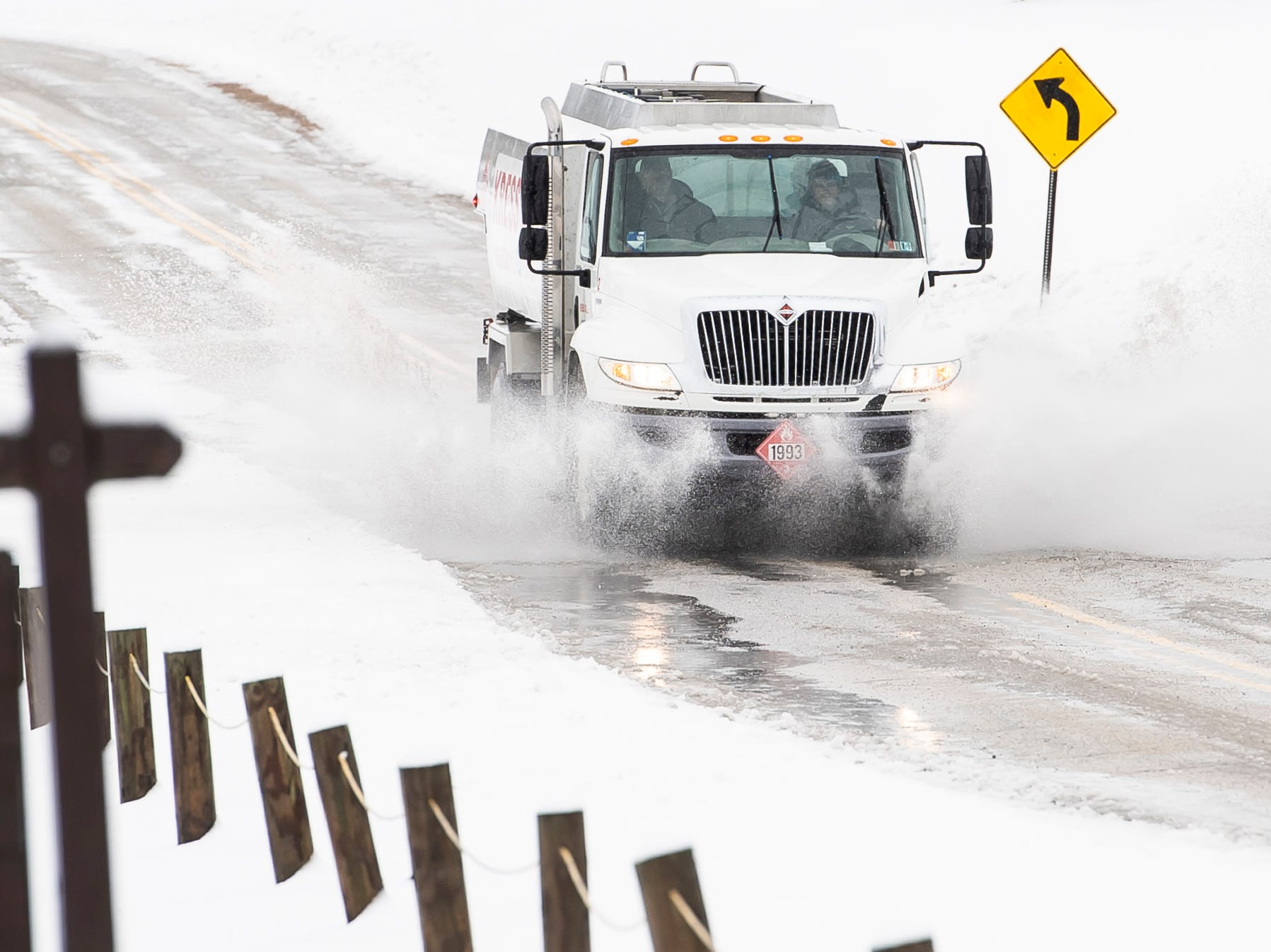 A truck drives through a large puddle of water on Grand Valley Road in West Manheim Township Tuesday, February 12, 2019. The National Weather Service in State College issued a winter storm warning for York and Adams counties effective until 4 p.m. Tuesday.