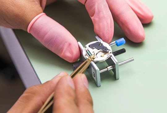 Armando Munoz assembles a watch movement at the FTS USA facility in Fountain Hills on Feb. 8, 2019.