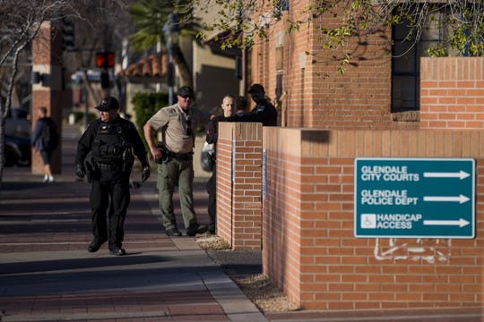 Glendale police officers stand outside headquarters on Feb. 11, 2019. The police department has faced scrutiny after body cam footage was released of officers repeatedly using a Taser on a man in 2017, resulting in a federal lawsuit and one officer's suspension.
